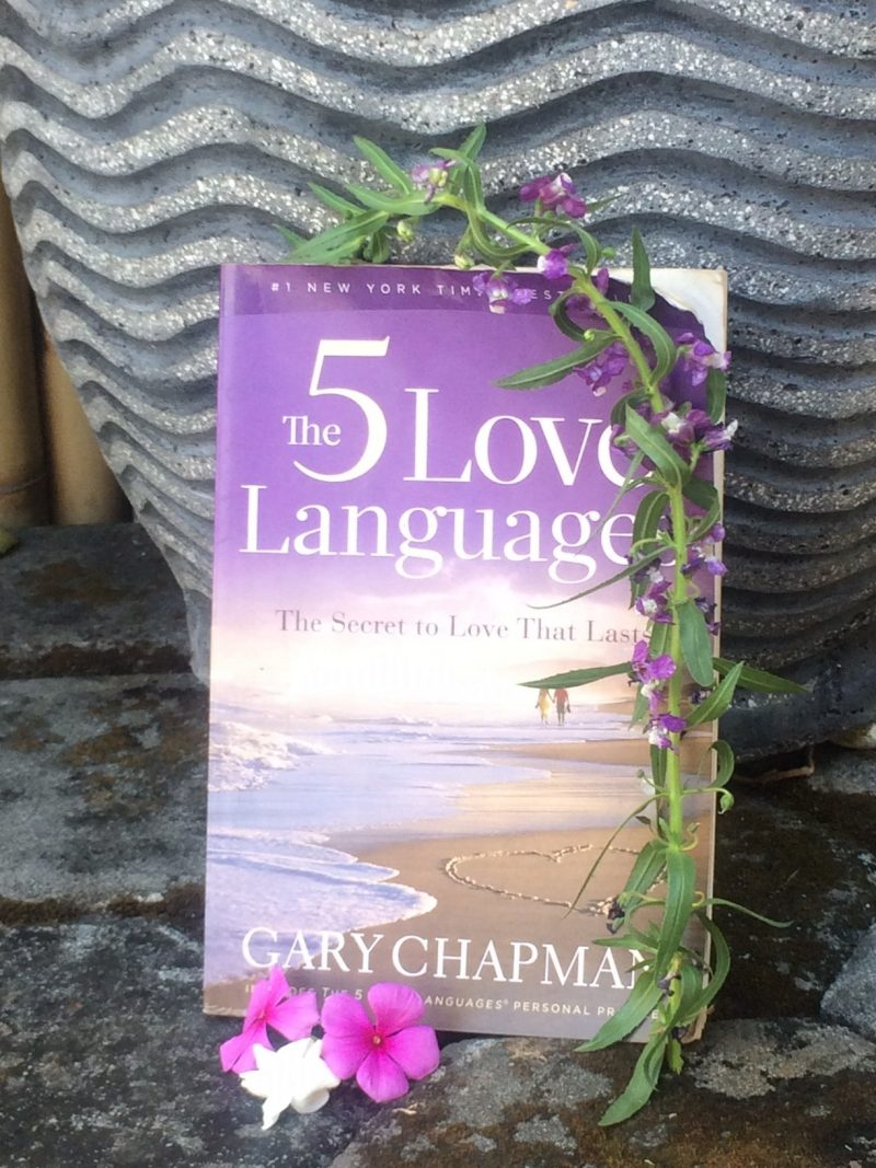 the 5 love languages book propped up on a pot