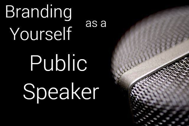branding yourself as a public speaker written next to a mic
