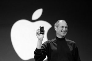 steve jobs holding up iphone branding yourself